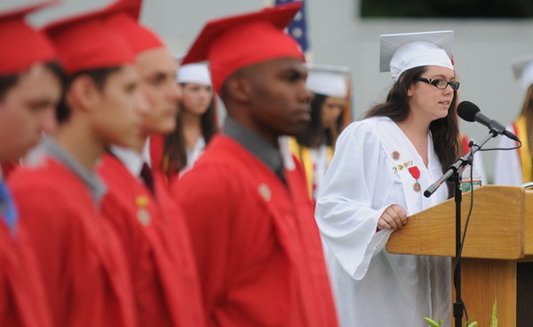 Amesbury: Kesley Little sings the National Anthem at the Amesbury high graduation at Landry Stadium Friday night. Jim Vaiknoras/staff photo