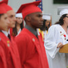Amesbury: Kesley Little sings the National Anthem at the Amesbury high graduation at Landry Stadium Friday night. Jim Vaiknoras/staff photo