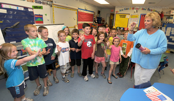 "Newburyport: Bresnahan school teacher Sue Labay sings "" Stop in the name of Love"" with her first grade class Thursday. Labay is retiring this year. Jim Vaiknoras/staff photo"