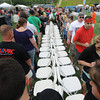 Amesbury: Participants walk in circles around a row of chairs at the Musical Chairs World Championships at Amesbury Sports Park Saturday. JIm Vaiknoras/staff photo
