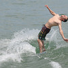 salisbury: Brian Bourassa or Tyngsboro does a back flip of his skim board while cooling off on Salisbury Beach Thursday. Jim Vaiknoras/staff photo