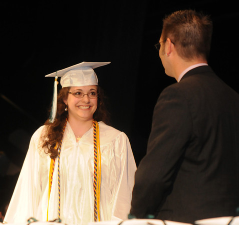 west Newbury: Salutatorian Katherine Randall is all smiles as she intoduces her drum teacher and  speaker Zach Field at the Pentucket Commencement Saturday. Jim Vaiknoras/staff photo