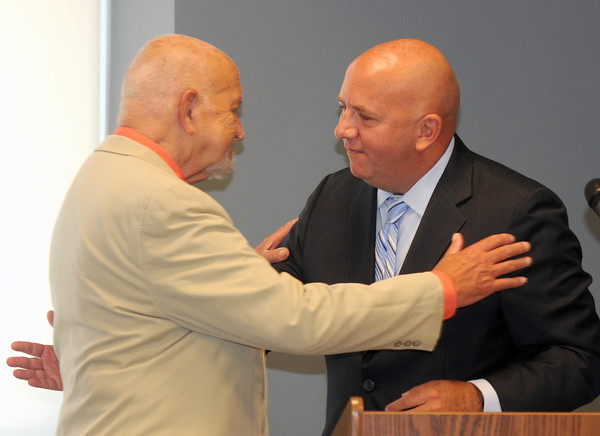 Amesbury: Mike Costello give his dad Nick Costello a hug at the ribbon cutting of the new Costello Transportation Center in Amesbury Friday. . JIm Vaiknoras./staff photo
