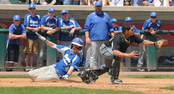 Lowell: Georgetown's Colby Ingraham slides safely home during the Royal's 5-2 victory over Northeast Metro in the Div 4 North Secional Championship at LeLacheur in Lowell Saturday. Jim Vaiknoras/staff photo
