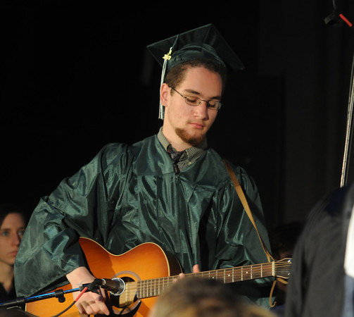 "west Newbury: Graduating senior Brent Perris plays accompanyment on ""Landslide"" at the Pentucket Commencement Saturday. Jim Vaiknoras/staff photo"