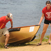 Amesbury: Steve Gwinn and Mollie Sydlowski pull their boat from the water as they finish the  fourth annual Lake Gardner Classic 5K Canoe and Kayak Race, sponsored by Lake Gardner Improvement Association Saturday morning. JIm Vaiknoras/staff photo
