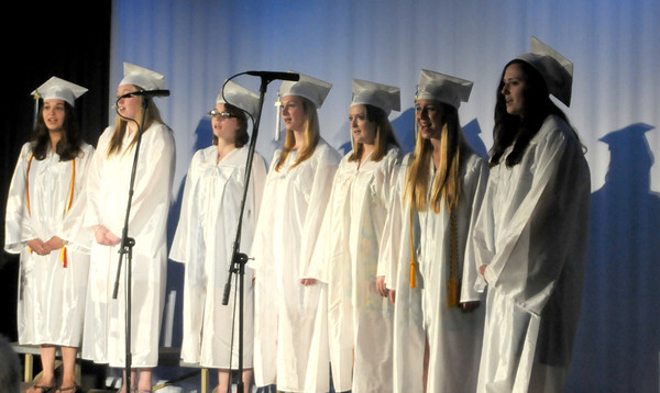 "west Newbury: Graduating seniors Caroline Carbone, Olivia Dunn, Megan Jordan, Shayna Joyce, Morgan Mahoney, Madison Scott and Brooke Snow perform ""Landslide"" at the Pentucket Commencement Saturday.They were accompanied by fellow graduate Brent Perris on Guitar. Jim Vaiknoras/staff photo"
