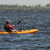 Newburyport: A fisherman on a kayak paddles along Joppa Flats Friday morning. Jim Vaiknoras/staff photo