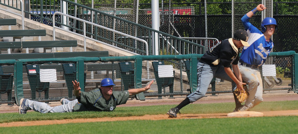 Lowell: Georgetown coach Justin Sturr makes the safe call as Colby Ingraham is save at 3rd during the Royal's 5-2 victory over Northeast Metro to claim the Div 4 North Secional Championship at LeLacheur in Lowell Saturday. Jim Vaiknoras/staff photo
