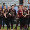 Lowell: Newburyport girl softball team walks off the field after their 2-0 loss to Winchester at Martin Field in Lowell THursday night. Jim Vaiknoras/staff photo