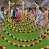 "Newburyport: Students march in under the ""Arch of Roses""  at the Newburyport High Graduation Ceremony at War Memorial Stadium  Sunday. jim Vaiknoras/staff photoa"