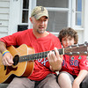 Newburyport: Newburyport firefighter Chris Richard and his son Jason at their Newburyport home.Chris will sing the national anthem Tuesday at Fenway. Jim Vaiknoras/staff photo