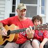 Newburyport: Newburyport firefighter Chris Richard and his son Jason at their Newburyport home.Chris will sing the national anthem Tuesday at Fenway. Jim Vaiknoras/staff photo