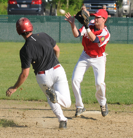 Rowley:Post 150's Adam Johnson makes a play on an attempted stolen base by a Middleton player during their game at Eiras in Rowley Saturday afternoon. Jim Vaiknoras/staff photo
