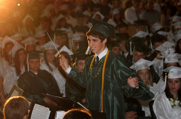"west Newbury: Joe D'Amore conducts the band in "" In the Shining of the Stars"" at the Pentucket Commencement Saturday. Jim Vaiknoras/staff photo"