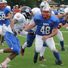 Durham: Pinkerton's Kevin Davis takes on a blocker while playing linebacker at the NH All-Star football game<br />  at UNH Saturday afyernoon. Jim Vaiknoras/staff photo