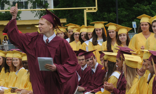 Newburyport: Benjamin Johnson gives the thumbs up to the crowd after getting his diploma at the Newburyport High Graduation Ceremony at War Memorial Stadium  Sunday. jim Vaiknoras/staff photoa
