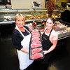 Salisbury:  Hiedi Bucciarelli and her mom Diane Reddington hold some NY strip Steaks at  Bucciarelli's Butcher Shop in Salisbury. JIm Vaiknoras/staff photo