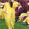 Newburyport: Sara Casey waves to the crowd after getting her diploma at the Newburyport High Graduation Ceremony at War Memorial Stadium  Sunday. jim Vaiknoras/staff photoa