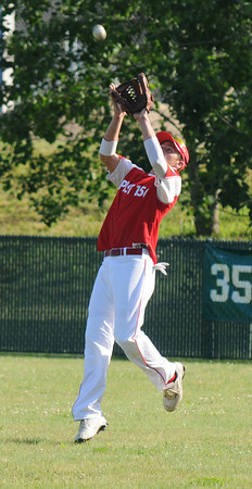 Rolwey: Posr 150's Colt Fontaine makes a play on the ball in right field duing their game against Middleton at Eiras Field in Rowley Saturday. Jim Vaiknoras/staff photo