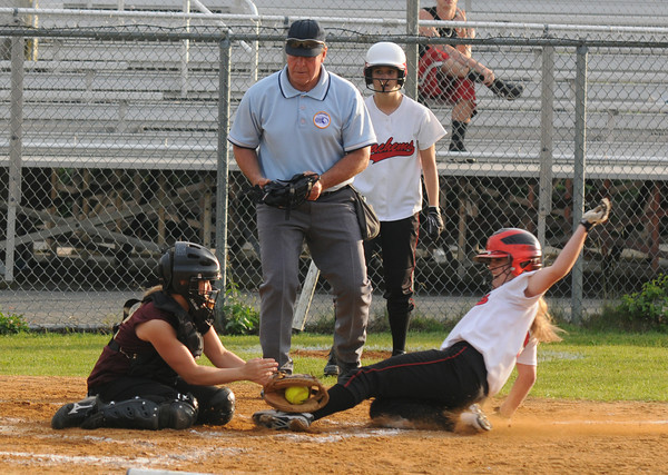 Lowell: Newburyport's Lauren Singer tags out Julia Staffiere during the Clippers 2-0 loss to Winchester at Martin Field in Lowell Thursday night. Jim Vaiknoras/staff photo