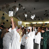 West Newbury: Graduates toss their caps at their conclusion at the Pentucket Commencement Saturday.Jim Vaiknoras/staff photo. Jim Vaiknoras/staff photo