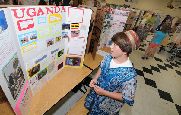 "Newburyport: Sixth grader Sam Crary talks about "" his country"" Uganda, at the Second annual International Expo at the Nock Middle School. Jim Vaiknoras/staff photo"