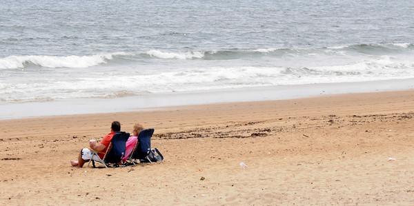 Salisbury: A couple relaxes on a nearly empty Salisbury Beach Tuesday afternoon. Jim Vaiknoras/staff photo