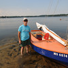 Merrimack: Dave Roche on his boat the Manding Wind on Lake Attitash in Merrimack. Roche teaches sailing to disabled kids. Jim Vaiknoras/staff photo