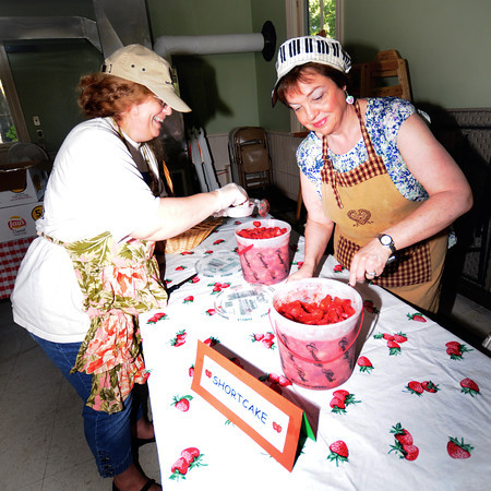 Amesbury : Jen Prince-Moughan and Ruth Trick make strawberry short cakes for the annual Short Cake Festival at the The Main Street Congregational Church in Amesbury. The event kicks off Amesbury Days. Jim Vaiknoras/staff photo