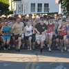 Newburyport: Twelve hundred runner take off on Merrimac street at the start of the Derek Hines Flag Day 5K. Thursday nght. Jim Vaiknoras/staff photo