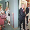 Amesbury: Amesbury Mayor Thatcher Kezer shakes hand wih Nick Costello at the ribbon cutting of the new Costello Transportation Center in Amesbury Friday. behind them are former mayor David Hildt and Peter Butler from teh Dept of Transportation. JIm Vaiknoras./staff photo
