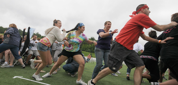 Amesbury: Participants rush to find a seat at the Musical Chairs World Championships at Amesbury Sports Park Saturday. JIm Vaiknoras/staff photo