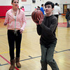 Newburyport: Newburyport High School student Kristin Cutter coaches Owen Robertson for an upcoming Special Olympics Unified Basketball game. Bryan Eaton/Staff Photo