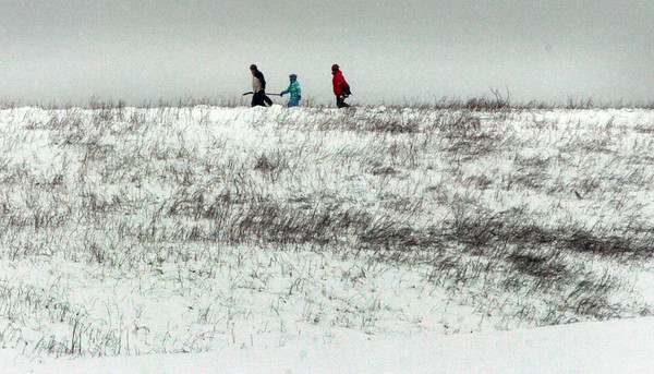 Amesbury: Sledders hit the slope at Woodsom Farm late yesterday morning as the snow started to let up a bit before getting heavier again later in the day. Bryan Eaton/Staff Photo