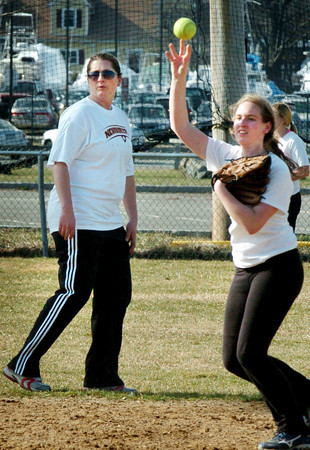 Newburyport: Newburyport High School's new softball coach Lori Solazzo, left, looks over her players during practice at Cashman Park. Bryan Eaton/Staff Photo