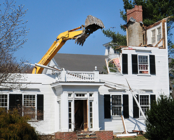 Newbury: The two hundred year-old home at 1 Little's Lane in Newbury finally came down yesterday afternoon. Bryan Eaton/Staff Photo