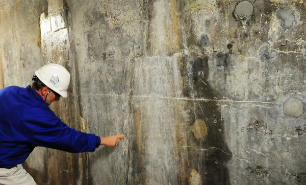 Seabrook: Ted Vassallo, NextEra Energy Seabrook system engineer in charge of the ASR issue shows where water has seeped into concrete. Bryan Eaton/Staff Photo