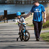 Newburyport: Jack Roche, 6, of Newburyport gets a hand from his father, Stephen, as he heads uphill along the Clipper City Railtrail while on training wheels on Thursday morning. Bryan Eaton/Staff Photo