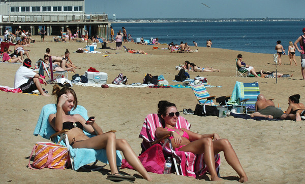 Salisbury: It wasn't July 4th, but March 22 as Emily Robichaud, left, of Princeton, and Alycia Sprague of Leicester spent yesterday afternoon at Salisbury Beach while on college break. It was another record-breaking day with temperatures wowing people all week, the start of spring on Tuesday. Bryan Eaton/Staff Photo