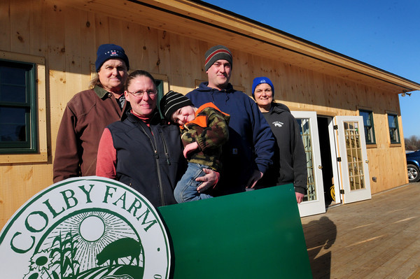 Newbury: The Colby family have expanded their farm stand on Scotland Road in Newbury. Bill Colby, left, and his wife, Lisa, right, with their son J.R. Colby, his wife, Liz Knight and their son, Scotty, 4. Bryan Eaton/Staff Photo