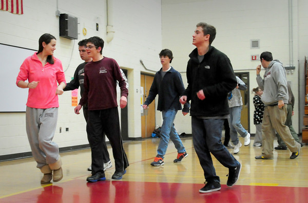 Newburyport: Newburyport High students along with special needs students warm up at the Nock Middle School as they get ready for the Special Olympics Unified Basketball game. Bryan Eaton/Staff Photo