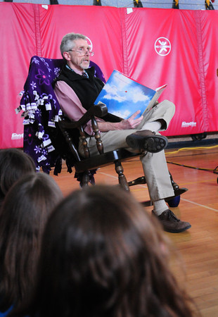 Merrimac: Donaghue School principal Robert C. Harrison sat in a big rocking chair as he read to the school in an assembly for  World Read Aloud Day on Wednesday. Bryan Eaton/Staff Photo