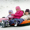 Newburyport: Despite yesterday's snowfall being the only substantial snowfall this season, only a few were out at March's Hill in Newburyport yesterday afternoon. Here sisters Elizabeth Metsker, 6, left, and Leah, 9, with friend, Emma Johnston, 8, right, all of Newburyport go down the hill together on their tubes. Bryan Eaton/Staff Photo