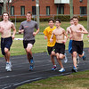 Newburyport: The defending CAL champion Newburyport boys track team  run laps at Fuller Field during practice yesterday. Bryan Eaton/Staff Photo