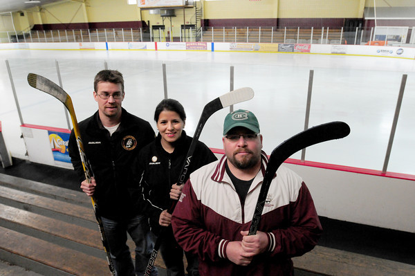 Newburyport: Coaches of the Newburyport Youth Hockey League will be playing Bruins alumni in a fundraising game. From left, board member Todd Elmore, and coaches Christina Lynch and Nate Buckley. Bryan Eaton/Staff Photo