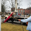 Newburyport: Charlie Nichols of the Waterfront Trust looks up at the flagpole next to the visitor's center in downtown Newburyport as crane operator Ken Taliadoros of Great Eastern Maritime tries to hoist the pole from its base. The trust wanted to make repairs and paint the pole, which was the main mast of the ship Gertrude L. Thebaud, but the pole wouldn't budge, so repairs will have to be made in place. Bryan Eaton/Staff Photo