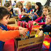 Newburyport: Daisy Troop 75336 members pack boxes of Girl Scout cookies to be donated to the Salvation Army food pantry. Bryan Eaton/Staff Photo