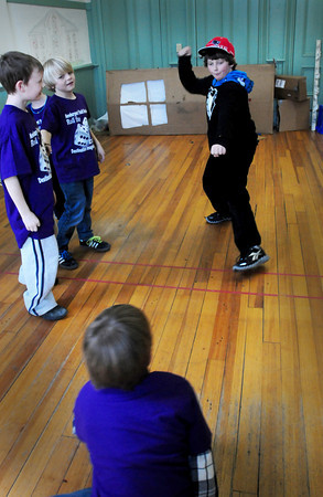 Newburyport: Cian Magauran, 9, plays the part of a lion tamer as his Destination Imagine team ad libs three circus acts at the Kelley School Teen Center in Newburyport. They have three teams that will be competing this weekend at Triton. Bryan Eaton/Staff Photo
