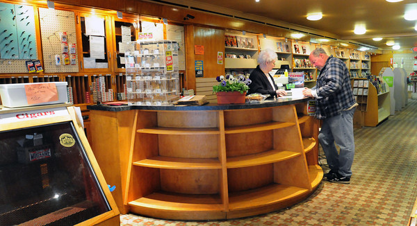 Newburyport: With many shelves empty, Fowle's Newsstand clerk Ruth Sullivan, manager Bill Harris do some paper work in the final hour of the store's existence. Bryan Eaton/Staff Photo